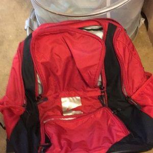 As is. Used Nike red swim backpack.